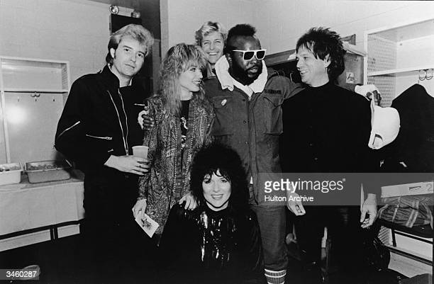 Members of the rock group Heart including Howard Leese Nancy Wilson Mark Andes Denny Carmassi and Nancy Wilson pose for a picture with actor MrT...