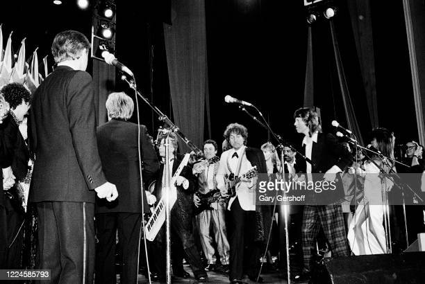 Members of the Rock Hall Jam Band perform onstage during the Third Annual Rock and Roll Hall of Fame Awards ceremony at the Waldorf Astoria Hotel,...