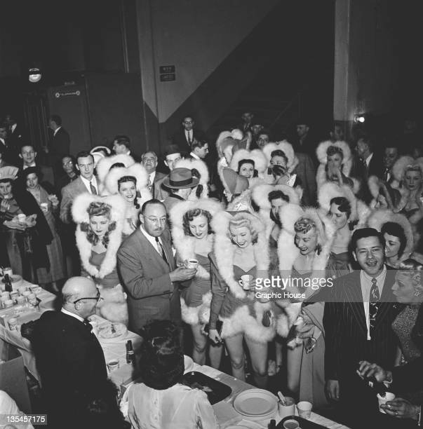 Members of The Rockettes precision dance company at a backstage party at the Radio City Music Hall in Manhattan New York City circa 1950 They are...