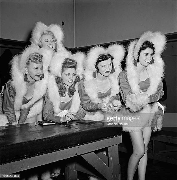 Members of The Rockettes precision dance company backstage at the Radio City Music Hall in Manhattan New York City circa 1950 They are wearing...
