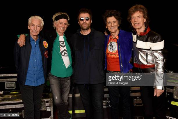 Members of The Rolling Stones Charlie Watts and Keith Richards Liam Gallagher Ronnie Wood and Mick Jagger of The Rolling Stones pose backstage during...