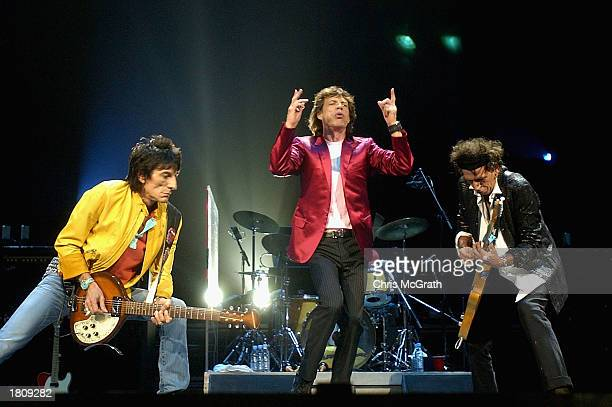 Members of the Rolling Stones Ronnie Woods Mick Jagger and Keith Richards perform live on stage at the Sydney Superdome February 22 2003 in Sydney...