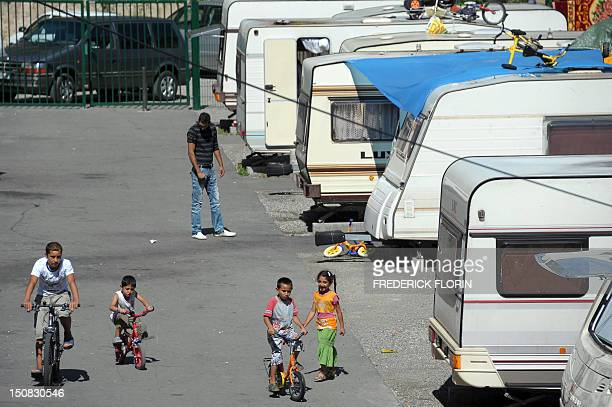 Members of the Roma community are pictured in a camp of caravans called 'Area16' on August 27 2012 in Strasbourg eastern France The 'Area 16' in...