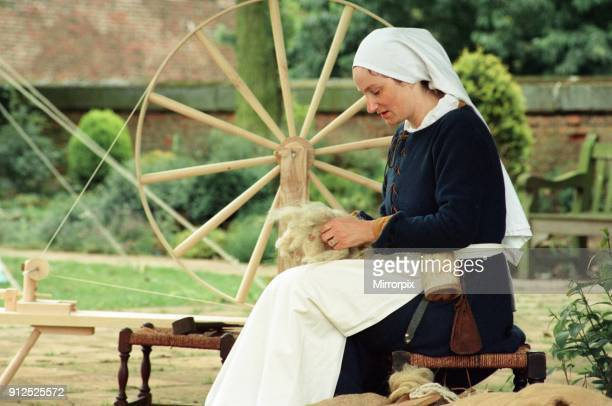 Members of the Rosa Mundi medieval society at their fair at Kirkleatham Old Hall Museum Adele Bolam at work carding wool for the spinning wheel 20th...
