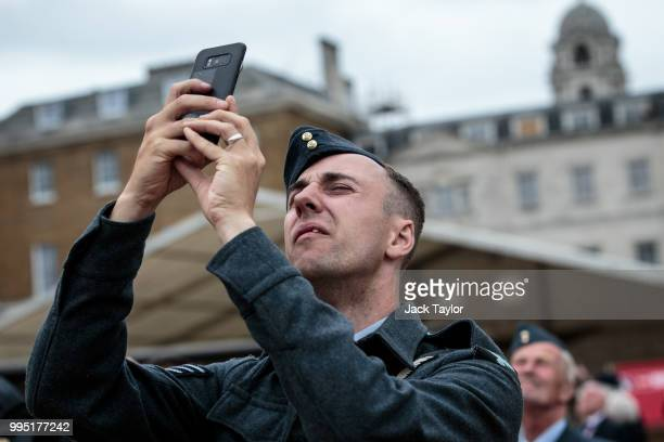 Members of the Royal Air Force take pictures at Horse Guards Parade during RAF 100 celebrations on July 10 2018 in London England A centenary parade...