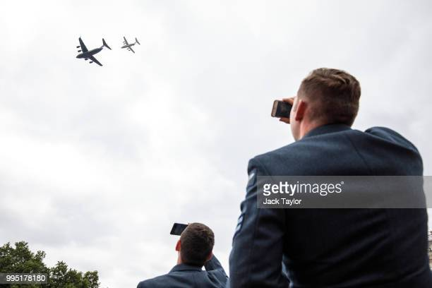 Members of the Royal Air Force watch a C17 Globemaster and a BAE146 aircraft fly over Horse Guards Parade during RAF 100 celebrations on July 10 2018...