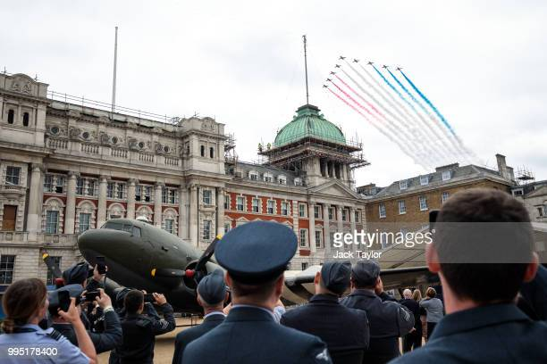 Members of the Royal Air Force watch the Red Arrows flypast over Horse Guards Parade during RAF 100 celebrations on July 10 2018 in London England A...