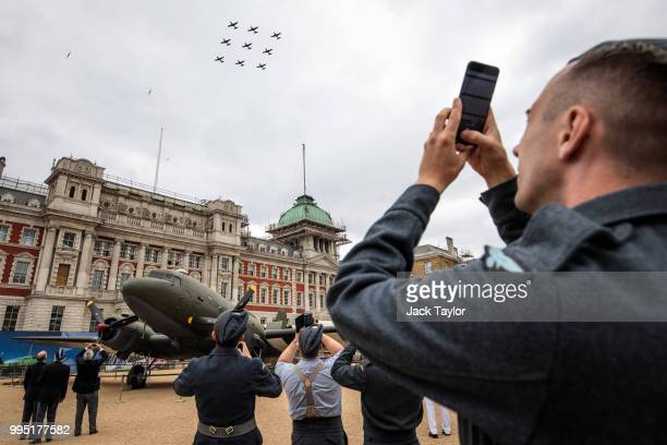 Members of the Royal Air Force watch the Tucano T1 aircraft flypast over Horse Guards Parade during RAF 100 celebrations on July 10 2018 in London...