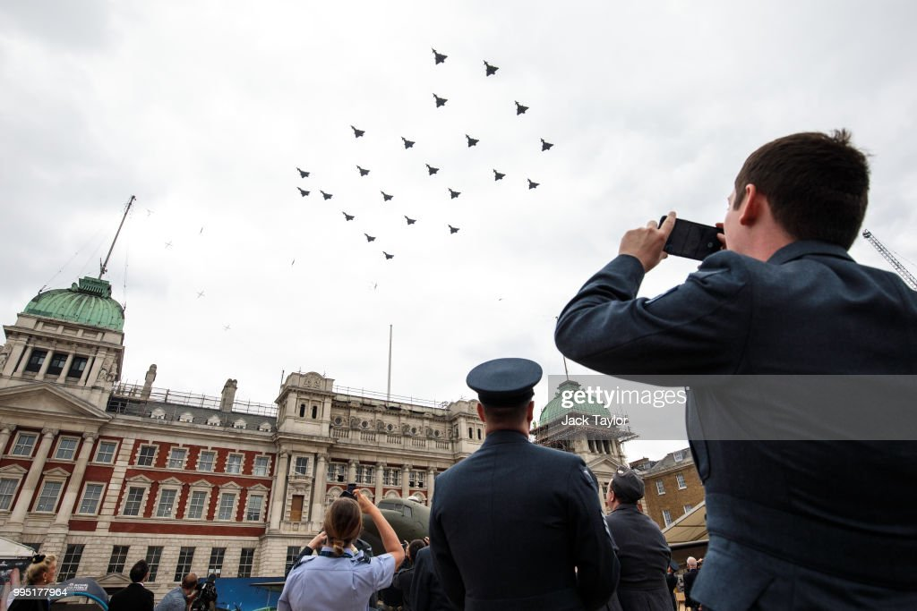 Members of the Royal Air Force watch the Typhoon FGR4 aircraft flypast over Horse Guards Parade during RAF 100 celebrations on July 10, 2018 in London, England. A centenary parade and a flypast of up to 100 aircraft over Buckingham Palace takes place today to mark the Royal Air Forces' 100th birthday.