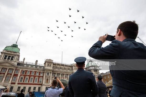 Members of the Royal Air Force watch the Typhoon FGR4 aircraft flypast over Horse Guards Parade during RAF 100 celebrations on July 10 2018 in London...