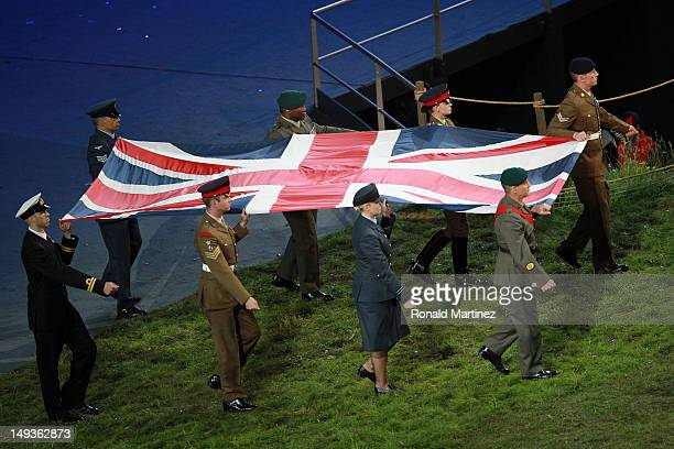 Members of the Royal Army, Navy and Airforce carry the Union Flag during the Opening Ceremony of the London 2012 Olympic Games at the Olympic Stadium...
