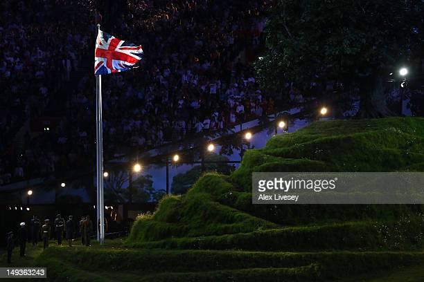 Members of the Royal Army, Navy and Airforce raise the Union Flag during the Opening Ceremony of the London 2012 Olympic Games at the Olympic Stadium...