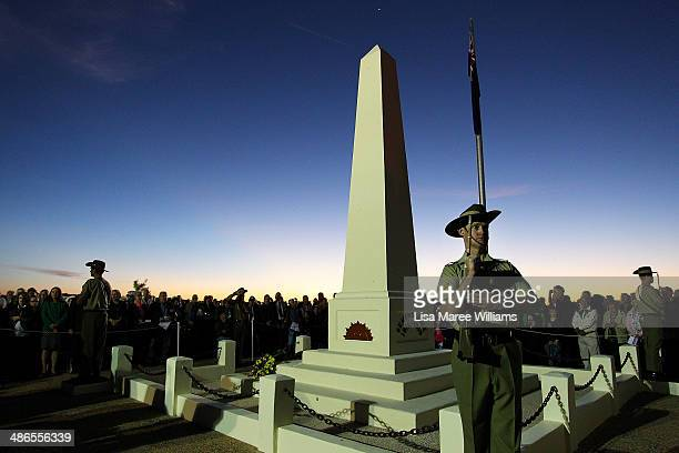 Members of the Royal Australian Army stand in silence near the Cenotaph during the Anzac Hill Dawn Service on April 25 2014 in Alice Springs...