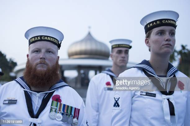 Members of the Royal Australian Navy attend the ANZAC Day Dawn Service in commemoration of the 104th anniversary of the ANZAC landing at Gallipoli,...
