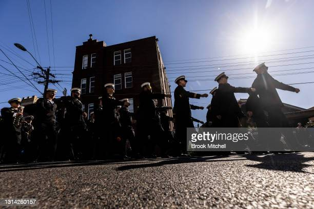 Members of the Royal Australian Navy take part in the ANZAC day march from the Coogee Diggers RSL to Coogee beach on April 25, 2021 in Sydney,...