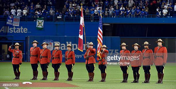 Members of the Royal Canadian Mounted Police carry the flags during a pregame ceremony ahead of Game 4 of the ALCS as the Toronto Blue Jays play host...