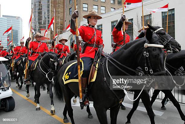 Members of the Royal Canadian Mounted Police parade through downtown February 23 2010 in Vancouver Canada