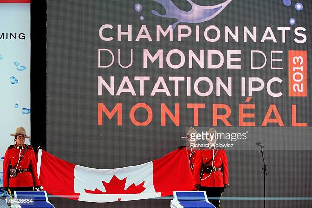 Members of the Royal Canadian Mounted Police present the Canadian flag during opening ceremonies of the IPC Swimming World Championships at Parc Jean...