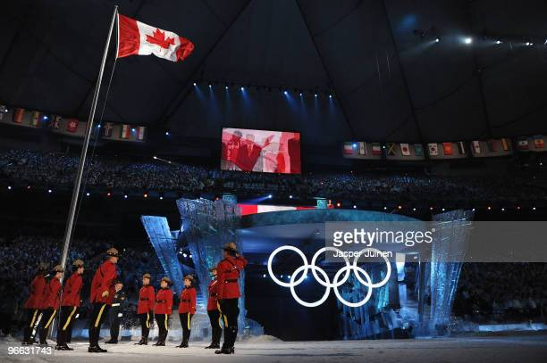 Members of the Royal Canadian Mounted Police raise the Canadian flag during the Opening Ceremony of the 2010 Vancouver Winter Olympics at BC Place on...