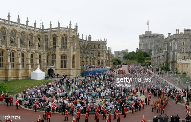 Members of the royal family and Knights Garter walk in procession from the Castle to St Georges Chapel for the annual service in the annual Garter...