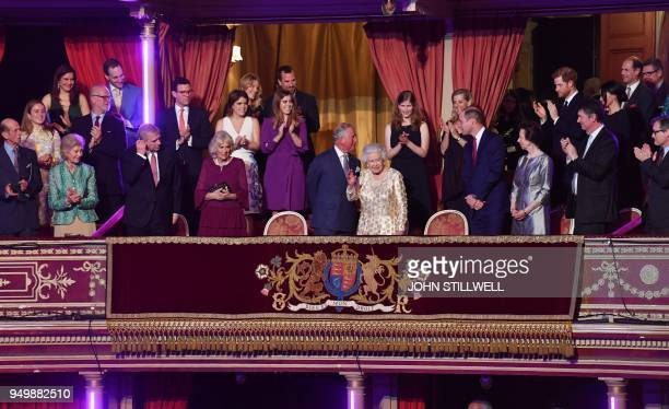 TOPSHOT Members of the Royal family applaud as Britain's Queen Elizabeth II waves to guests as she takes her seat in the Royal box for The Queen's...