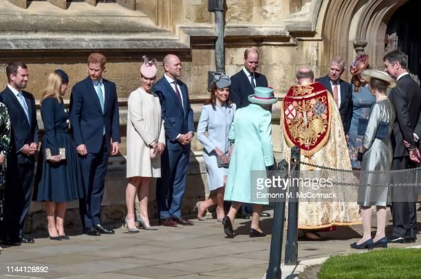 Members of the royal family greet Queen Elizabeth II as she arrives for the Easter Sunday service at St George's Chapel on April 21 2019 in Windsor...