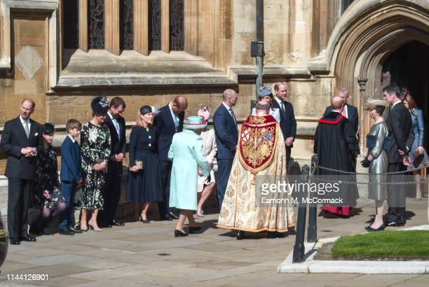 Members of the royal family greet Queen Elizabeth II as she arrives for the Easter Sunday service at St George's Chapel on April 21, 2019 in Windsor,...