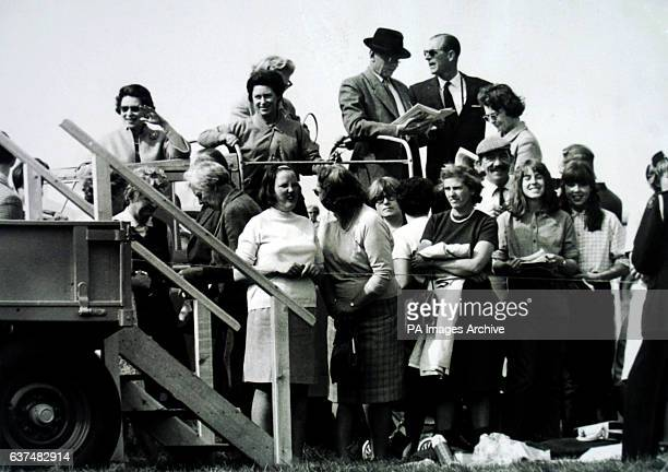 Members of the Royal Family including Queen Elizabeth II back left Princess Margaret second back left and the Duke of Edinburgh back right at...