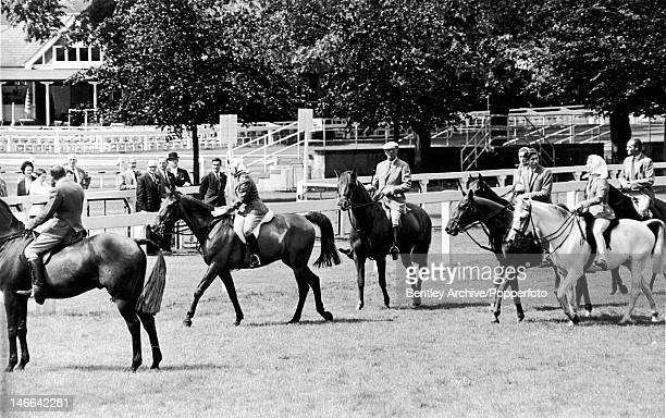 Members of the royal family on the course at Ascot, 20th June 1968. Amongst them are Queen Elizabeth II, Prince Charles and Katharine, Duchess of...