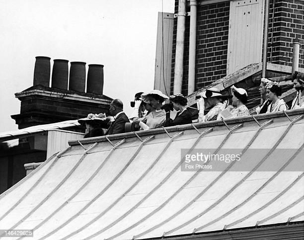 Members of the royal family on the roof of the Royal Box during Ladies' Day at Ascot, 17th June 1954. From left to right, the Duchess of Gloucester,...