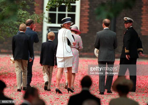 Members of the Royal Family walk back to Clarence House on a carpet of poppies dropped by a Lancaster bomber as part of the VJ Day 50th Anniversary...