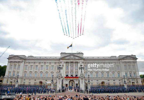 Members of the Royal Family watch a flypast to mark the centenary of the Royal Air Force from the balcony of Buckingham Palace on July 10 2018 in...