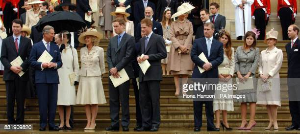 Members of the Royal Family watch Britain's Queen Elizabeth II and the Duke of Edinburgh depart St George's Chapel Windsor Castle following a special...