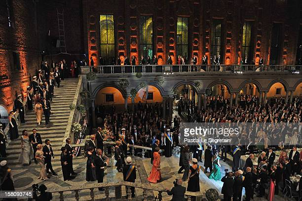 Members of the Royal family with Crown Princess Victoria of Sweden and Nobel Prize laureates walk down the stairs as they arrive for Nobel Banquet at...