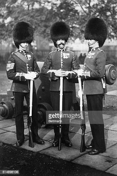 Members of the Royal Life Guard with tall bearskin caps and rifles
