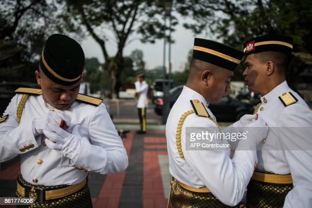 TOPSHOT Members of the Royal Malay Regiment Guard of Honour prepare for the welcoming ceremony of Qatar's Emir Sheik Tamim bin Hamad alThani at the...