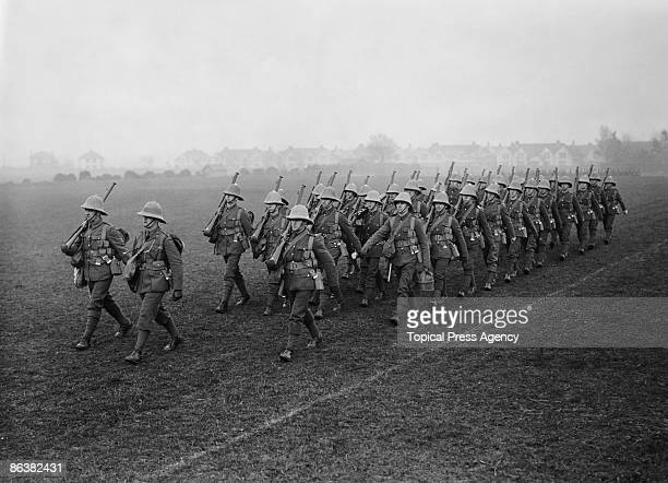 Members of the Royal Marines at marching drill on the parade ground at Eastney Barracks Portsmouth January 1927 They are about to embark for China