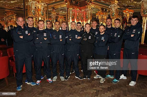 Members of the Royal Marines Boxing Association and the Royal Navy Boxing Association pose at the Royal Marines Boxing Bout at Cafe Royal in...