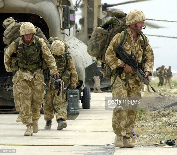 Members of the Royal Marines of 45 Commando return to Bagram Airbase after completing an Operation Condor mission May 22 2002 in Afghanistan