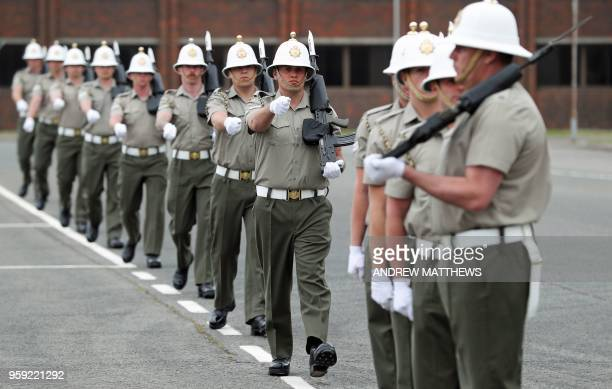Members of the Royal Marines practice their ceremonial support ahead of the wedding of Britain's Prince Harry and his fiance US actress Meghan...
