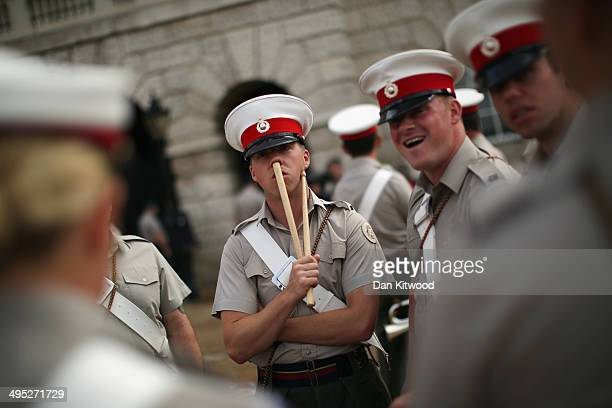 Members of the Royal Marines rehearse for the ceremonial 'Beating Retreat' event on Horse Guards Parade on June 2 2014 in London England The event is...