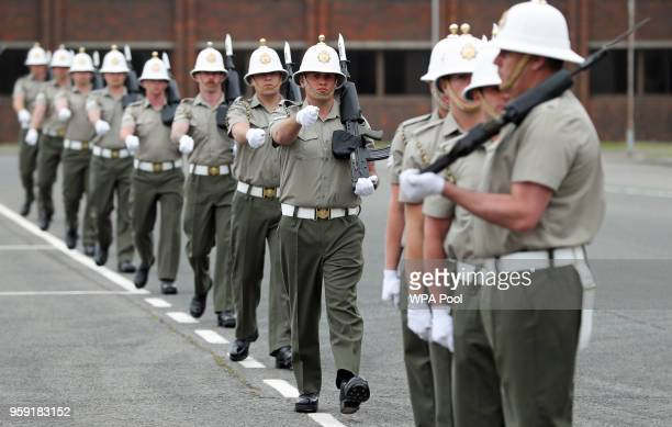 Members of the Royal Marines take part in a final rehearsal ahead of their role in the Armed Forces' ceremonial duties at the royal wedding at HMS...