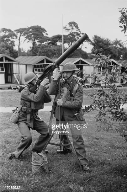 Members of the Royal Militia of the Island of Jersey a unit of the British Army aim a Lewis Gun at potential enemy aircraft at their camp on Jersey...