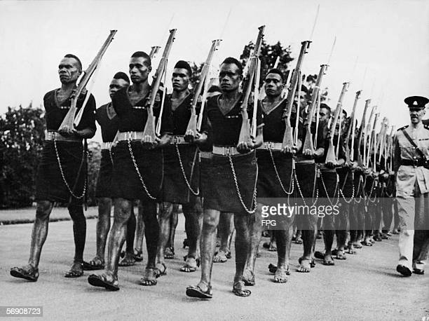Members of the Royal Papuan Constabulary dressed in uniform hold rifles and march in the ANZAC day parade through Sydney Australia April 25 1950...