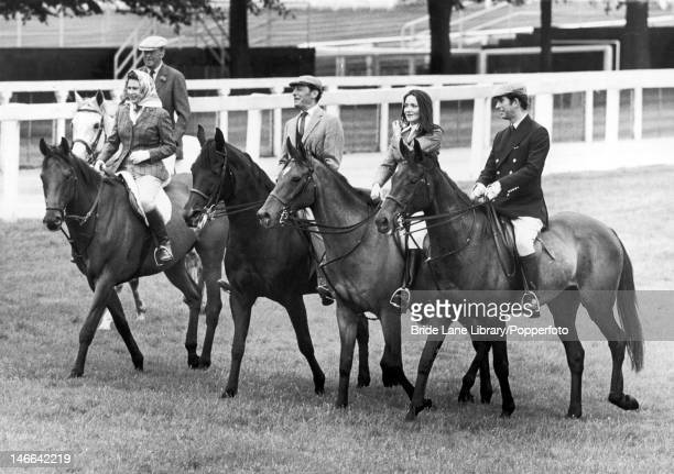 Members of the royal party ride around the racecourse at Ascot, prior to the Gold Cup day race, 19th June 1975. From left to right, the 10th Duke of...