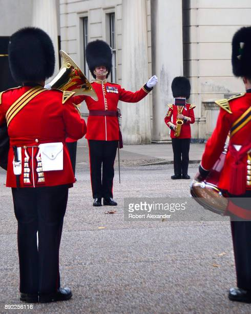 Members of the royal Regimental Band perform at Wellington Barracks before marching to nearby Buckingham Palace where they will participate in the...