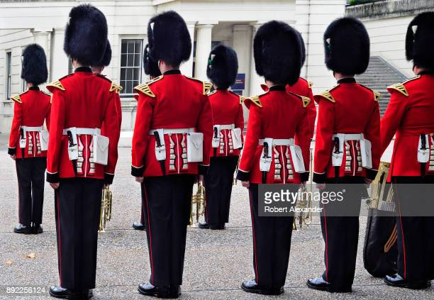 Members of the royal Regimental Band stand for inspection at Wellington Barracks before marching to nearby Buckingham Palace where they will...