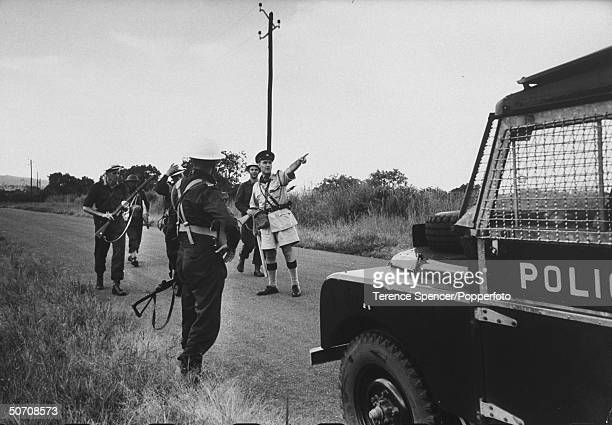 Members of the royal Rhodesia regiment on way to Kariba Dam to guard installation during strike by African workers