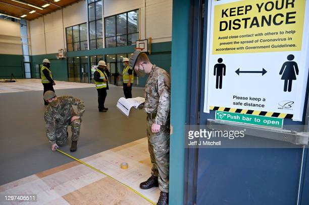 Members of the Royal Scots Dragoon Guard set up a coronavirus vaccination centre at the Donald Dewar Sports Centre, Drumchapel on January 20, 2021 in...