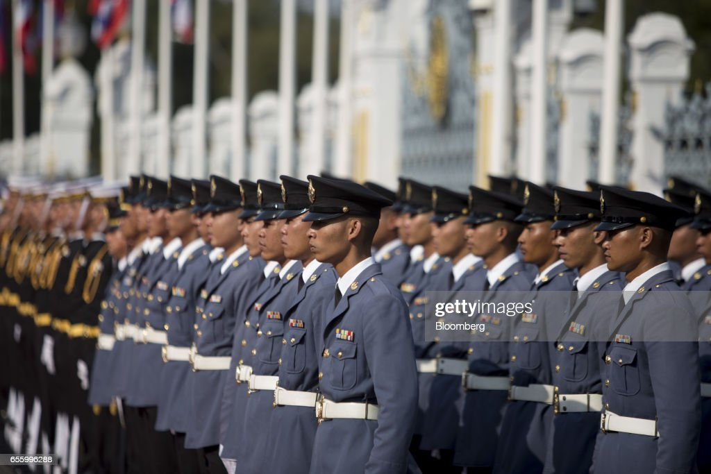 Members of the Royal Thai Air Force stand to attention ahead of a news conference at Government House in Bangkok, Thailand, on Tuesday, March 21, 2017. Duterte returns to the Philippines on March 22. Photographer: Brent Lewin/Bloomberg via Getty Images